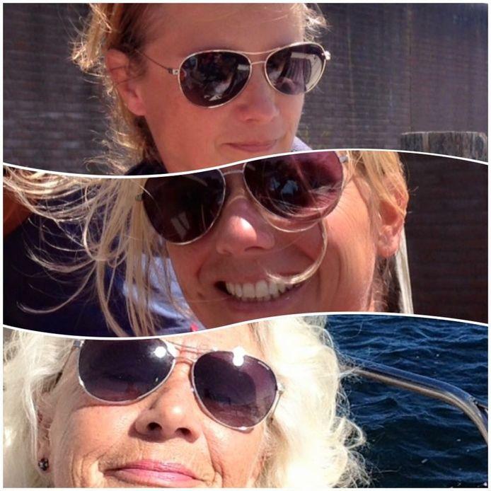 ZONNEBRILLENTRIO Janny geniet met haar dochters Esther en Susanne van de zon op het water bij Steenbergen.