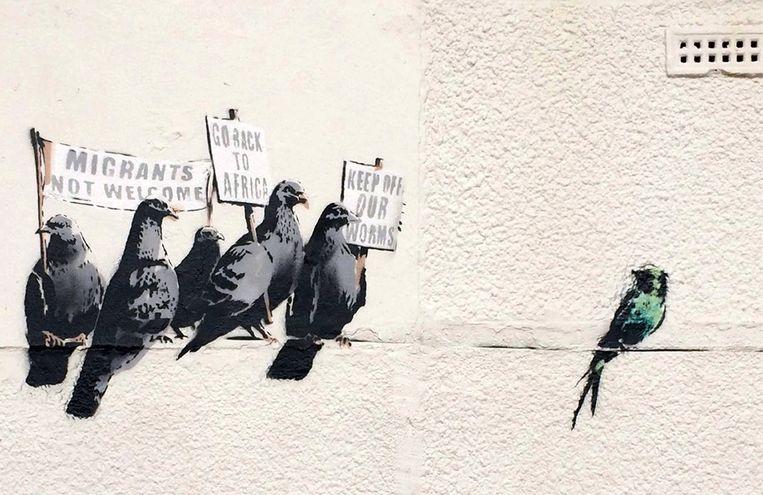 Muurschildering van straatkunstenaar Banksy in Clacton-on-Sea. Beeld null