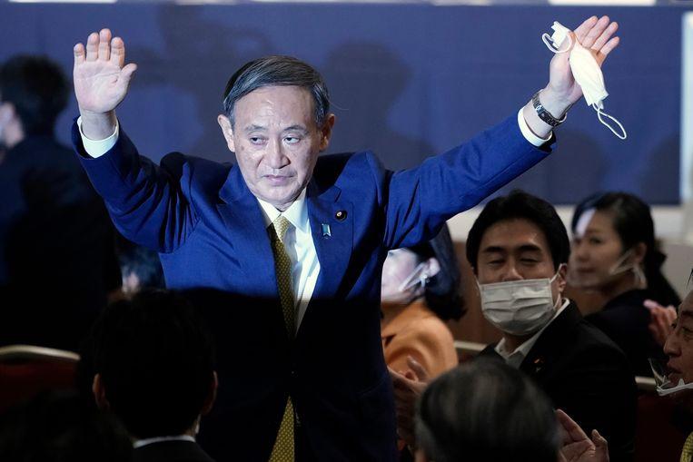 Yoshihide Suga na de bekendmaking dat hij de Liberaal Democratische Partij gaat leiden.  Beeld EPA