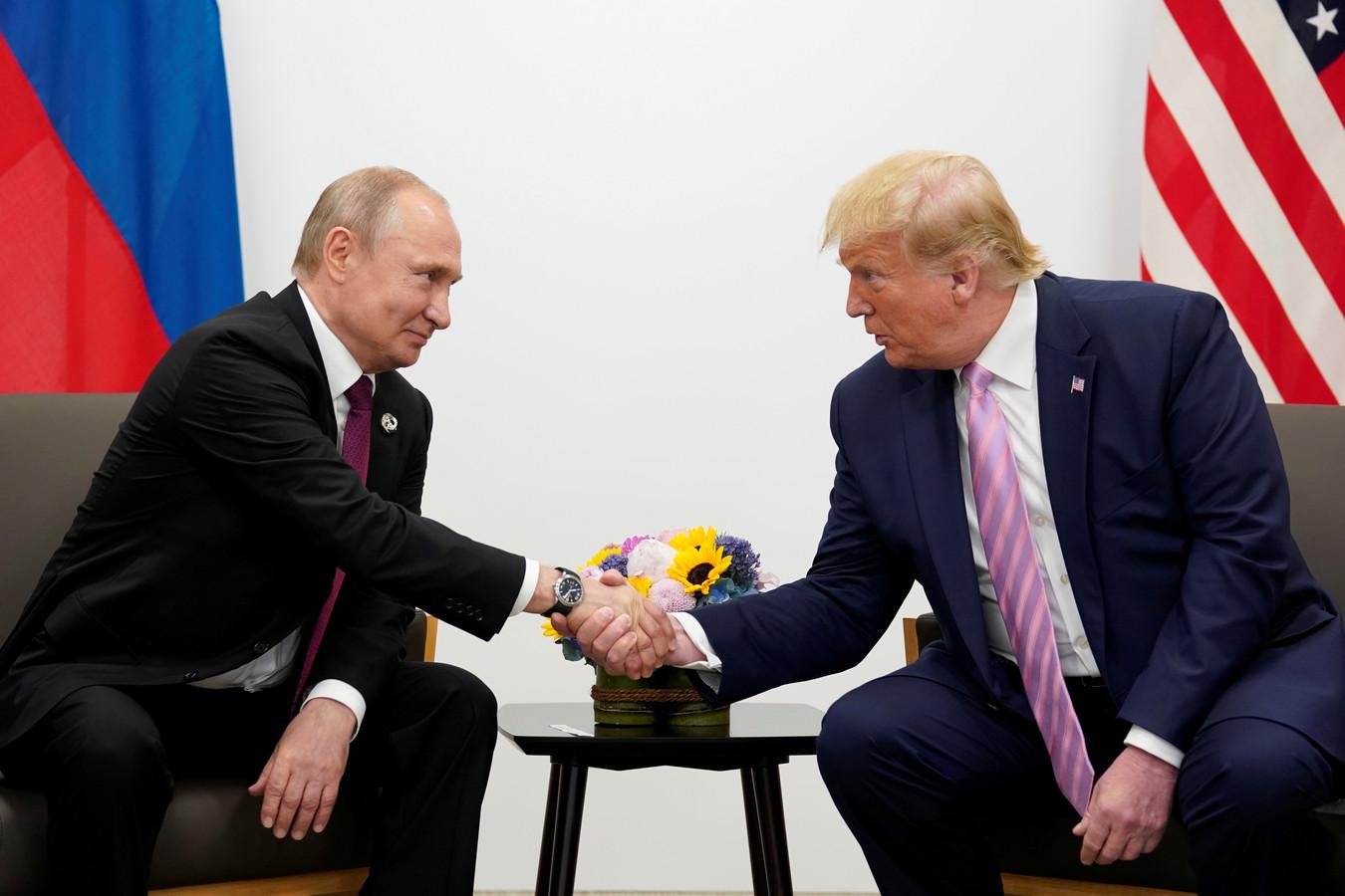 De Russische leider Poetin en de Amerikaanse president Trump, vorig jaar tijdens een ontmoeting in Japan.