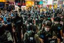 De politie in de straten van Hongkong.