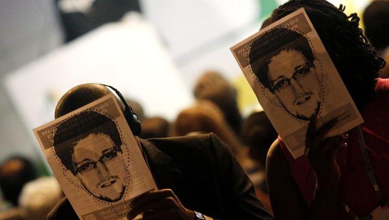 Betogers met Snowdenmasker pleiten voor meer privacybescherming.