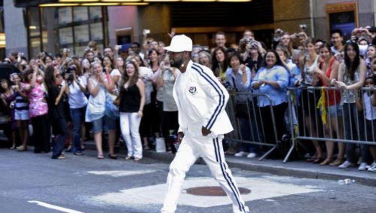 Wyclef Jean loopt naar het evenement in het hart van Manhattan. Foto ANP Beeld