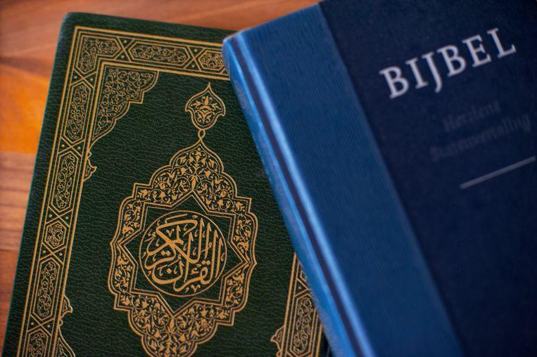 Bijbel en een koran. Beeld ANP XTRA ROOS KOOLE
