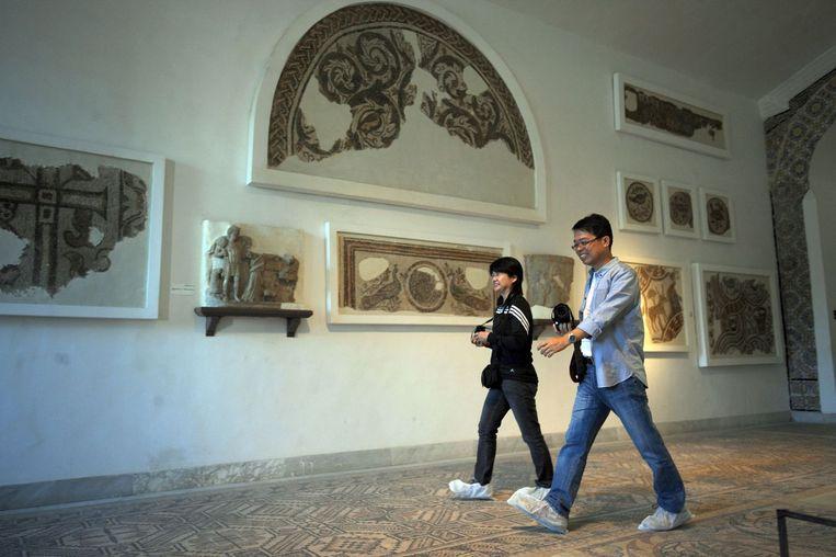 Japanse toeristen in het Bardo-museum op archiefbeeld. Beeld afp