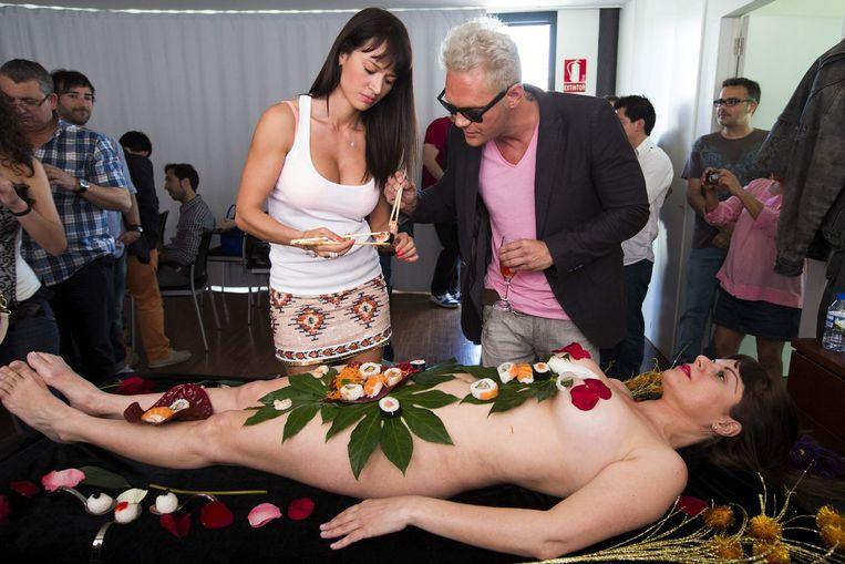 Porno-acteurs Franceska Jaimes (links) en Nacho Vidal (rechts) op een erotica-beurs in Spanje in 2013.