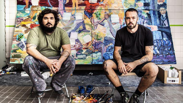 Thiago Martins de Melo (links) en zijn kompaan Paulo Nimer Pjota in hun tijdelijke werkruimte in Utrecht. Beeld Aurélie Geurts
