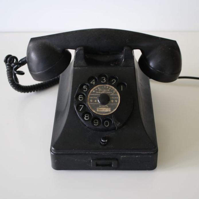 Telefoon met draaischijf uit het jaar 1964.