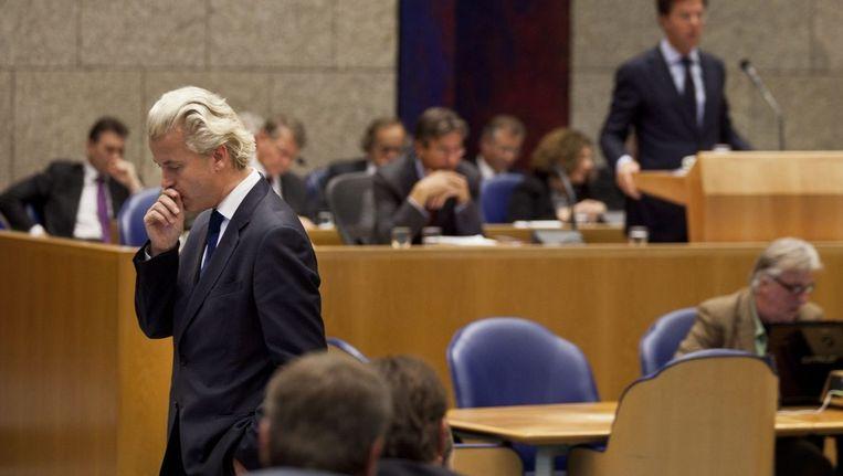 Geert Wilders tijdens de Algemene Beschouwingen. Op de achtergrond premier Rutte. Beeld epa