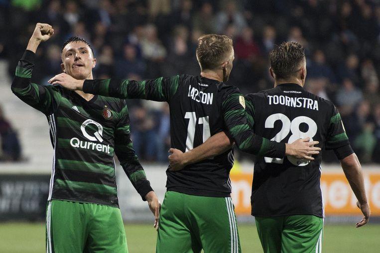 Feyenoord-spelers Steven Berghuis, Sam Larrsson en Jens Toornstra vieren de 2-4. Beeld anp