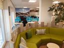 De loungehoek, werkplekken: uniforme huisstijl met Tilburg-look.