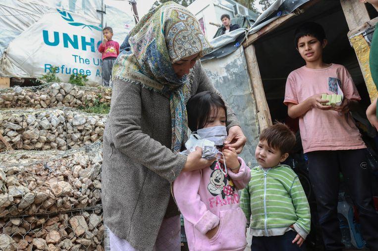 Vluchtelingen in kamp Moria op het Griekse eiland Lesbos. Beeld AFP
