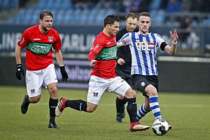 FC Eindhoven speler Branco van den Boomen (R) tegen NEC speler Brahim Darri en Joey van den Berg tijdens de wedstrijd Eindhoven - NEC.