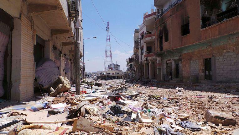 Verwoeste gebouwen in Deraa, waar de Syrische opstand in maart 2011 begon. Beeld REUTERS