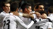 Real klopt Sevilla met nodige moeite en zet 'Barça' op 4 punten: 2-1