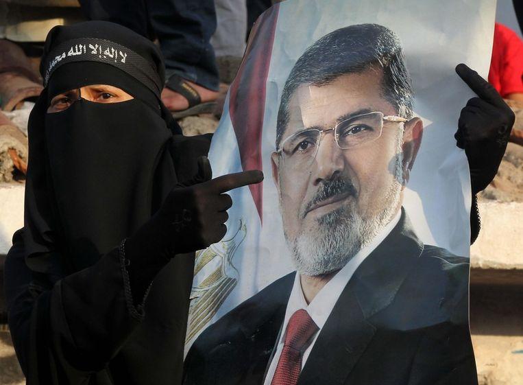 Protest tegen arrestatie van Morsi in juli. Beeld epa