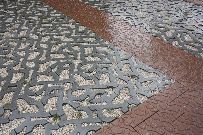 Rain(away) uit Eindhoven won een Red Dot Design Award voor deze waterdoorlatende tegel.