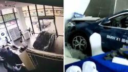 Testrit met BMW loopt fout: Chinese rijdt in volle vaart toonzaal binnen