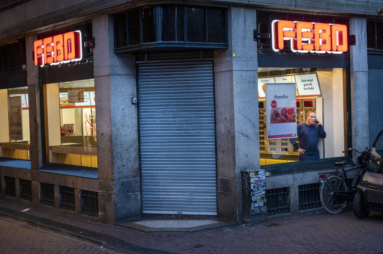 Een gesloten filiaal van Febo in maart, vlak nadat het kabinet besloot de horeca te sluiten om verspreiding van het coronavirus tegen te gaan. Beeld ANP