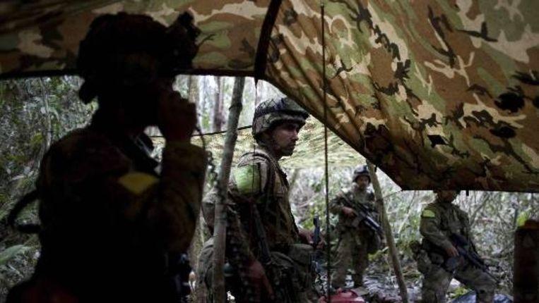 Colombiaanse soldaten in actie tegen de rebellenbeweging FARC in Puerto Rico, Colombia. (AP) Beeld