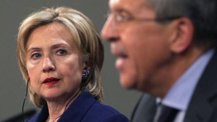 De Amerikaanse minister van Buitenlandse Zaken Hillary Clinton (L) en haar Russische ambtgenoot Sergej Lavrov. ANP Beeld