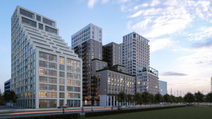Het ontwerp van (vlnr) Sixty5 (halverwege met de bouw), The Fizz (net gestart) en Next (bouw begint in najaar) op Strijp-S aan de Philitelaan in Eindhoven.