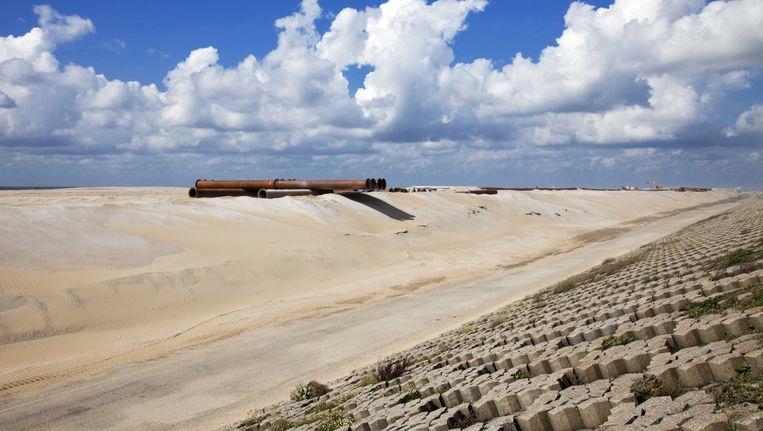 Bij de Hongdsbossche Zeewering werd vorig jaar gewerkt aan de kust. Beeld ANP