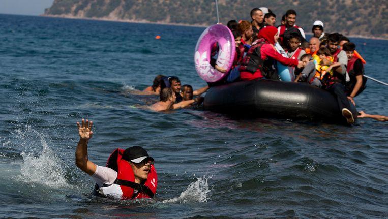 Syrische vluchtelingen komen aan op Lesbos, in Griekenland. Beeld AP