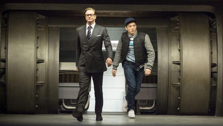 Colin Firth en Taron Egerton in Kingsman: The Secret Service Beeld 20th Century Fox
