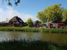 Brand in schuur bij woning in Opheusden