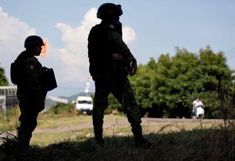 Soldaten patrouilleren nadat agenten in een hinderlaag van een drugskartel terechtkwamen in El Aguaje vorige maand.