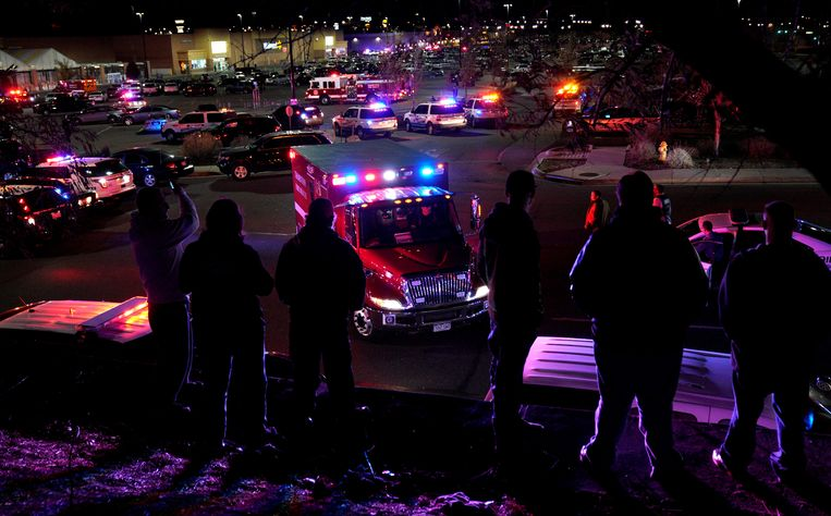 People watch an ambulance leave at the scene of a shooting at a Walmart in Thornton, Colorado November 1, 2017.  REUTERS/Rick Wilking
