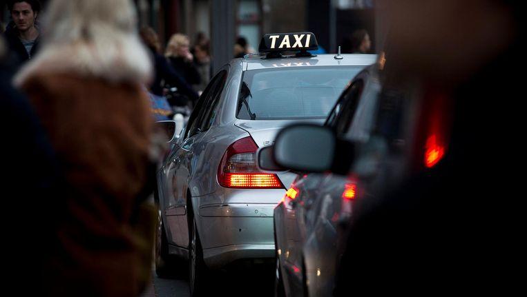 De laatste maand constateren taxichauffeurs steeds vaker dat spooktaxi's in de binnenstad actief zijn Beeld anp