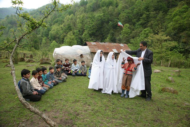 Een religieus feest op school. Beeld Mohammad Golchin