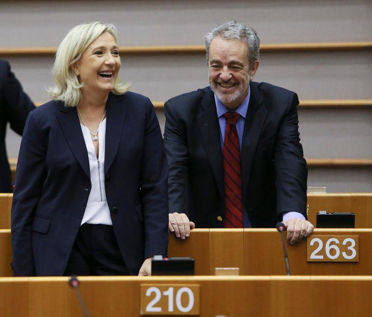 Gerolf Annemans (R) en Marine le Pen. Beeld epa