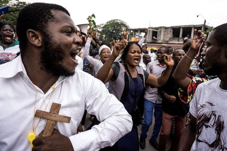 De katholieke kerk riep volgelingen op de straat op te gaan. Beeld AFP