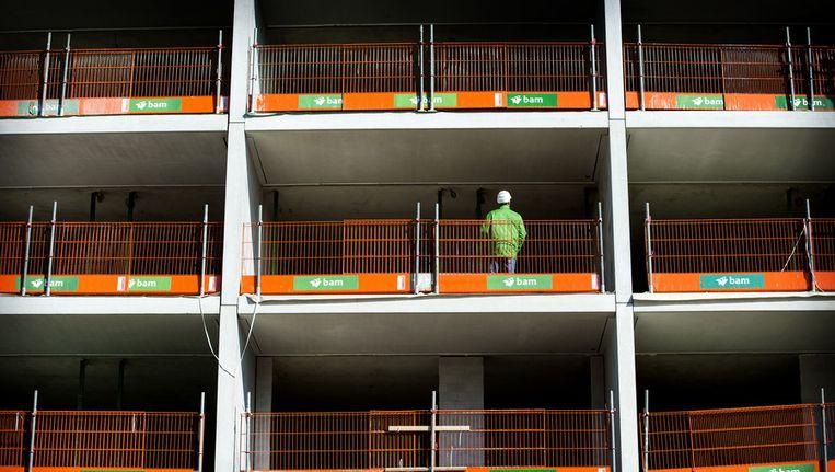 Een bouwvakker aan het werk op een bouwplaats in Utrech Beeld anp