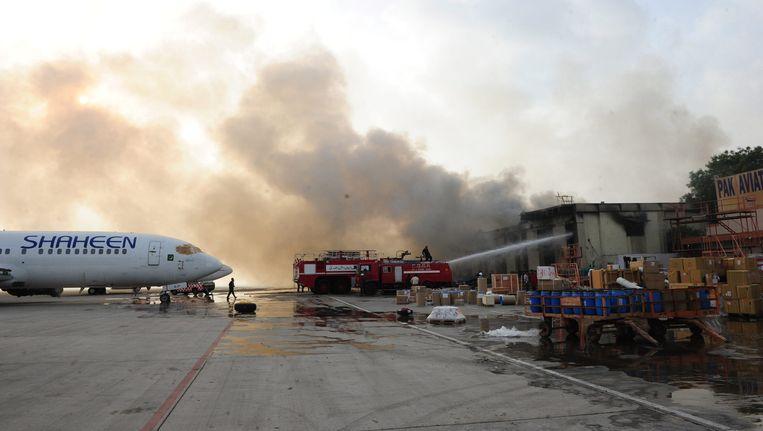 Het vliegveld in Karachi vanochtend vroeg. Beeld EPA