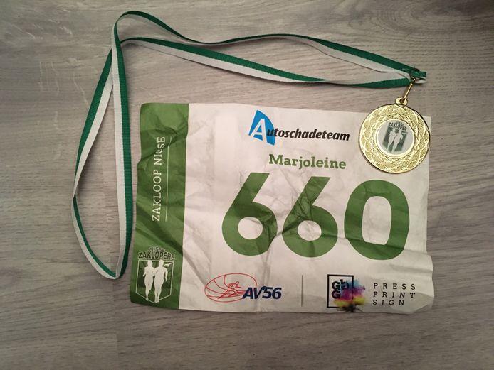 Mijn medaille en startnummer