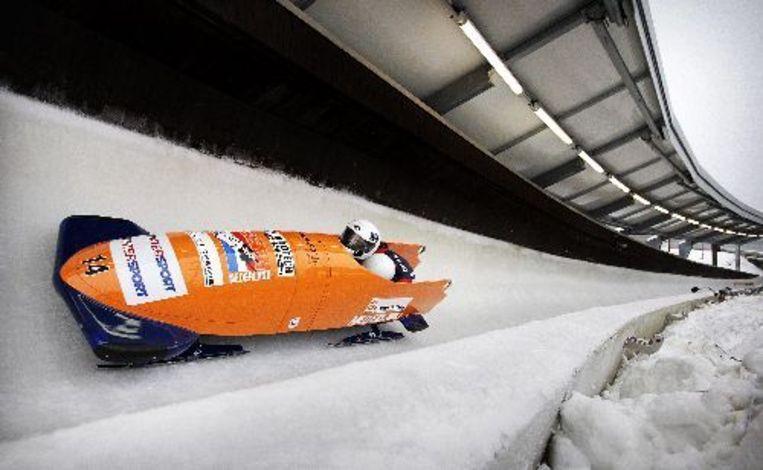 De Nederlandse bobsleesters Esmé Kamphuis (voor) en Tine Veenstra hebben zich geplaatst voor de Olympische Spelen. ANP Beeld