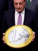European Central Bank President Mario Draghi takes part in a group photo while celebrating the 20th anniversary of the euro during a eurozone finance ministers meeting in Brussels