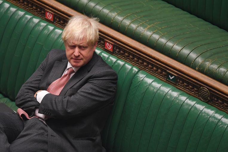 Premier Boris Johnson in het Britse Lagerhuis tijdens de behandeling van de omstreden brexitwet.  Beeld EPA