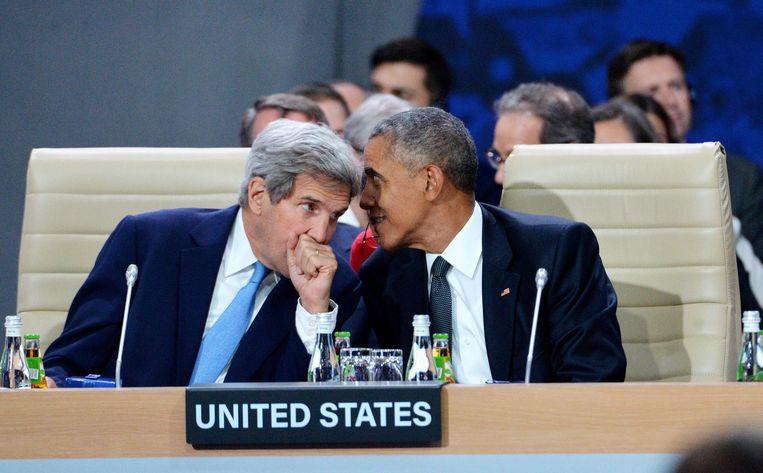 John Kerry en Barack Obama bij een NAVO-top op 8 juli 2016 in Polen. Beeld null