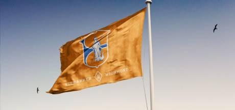 Jubileumvlaggen Vierakker-Wichmond vliegen over de toonbank