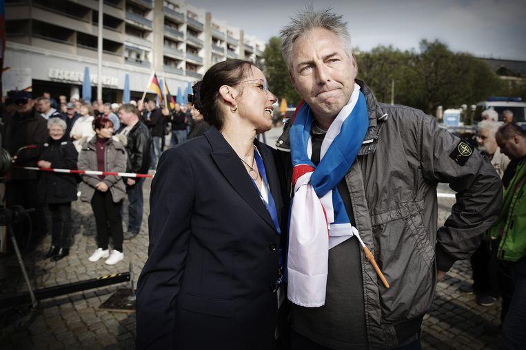 Wagensveld met Tatjana Festerling, de vrouw die hij naar Pediga haalde en die nu het gezicht van de beweging in Duitsland is. Beeld Falko Siewert