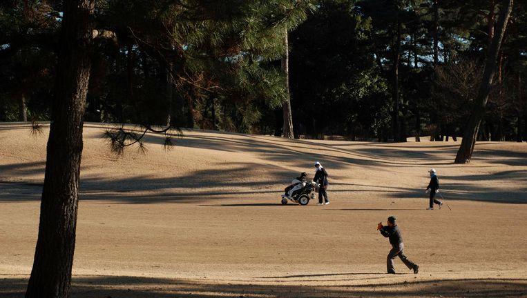 Spelers op de Kasumigaseki golfbaan Beeld Reuters