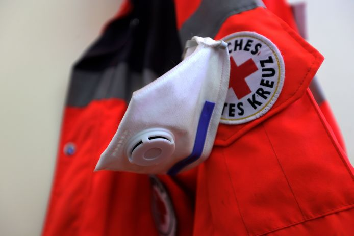 A FFP3 protective mask hangs on a jacket of the German Red Cross.
