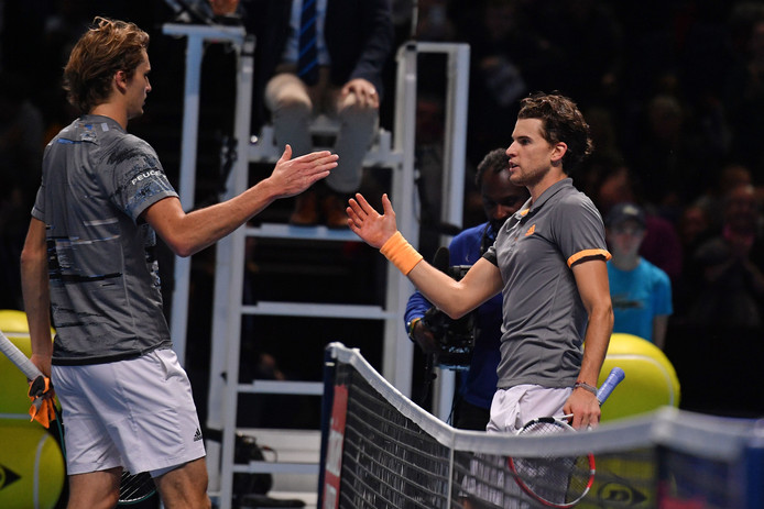 Austria's Dominic Thiem (R) shakes hands with Germany's Alexander Zverev (L) after  his straight sets victory in the men's singles semi-final match on day seven of the ATP World Tour Finals tennis tournament at the O2 Arena in London on November 16, 2019. (Photo by Daniel LEAL-OLIVAS / AFP)