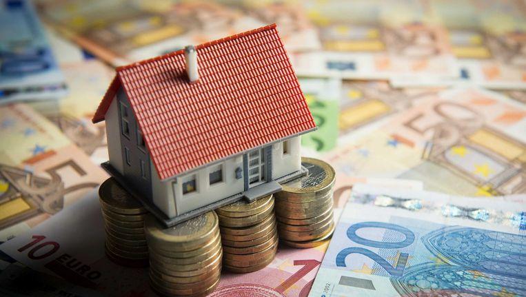 Huizenbezitters die hun hypotheek het afgelopen jaar hebben overgesloten en te veel 'boeterente'betaalden krijgen geld terug. Beeld anp