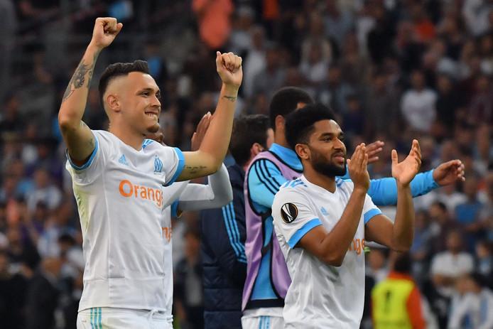 Lucas Ocampos (links) en Jordan Amavi van Marseille vieren de overwinning.